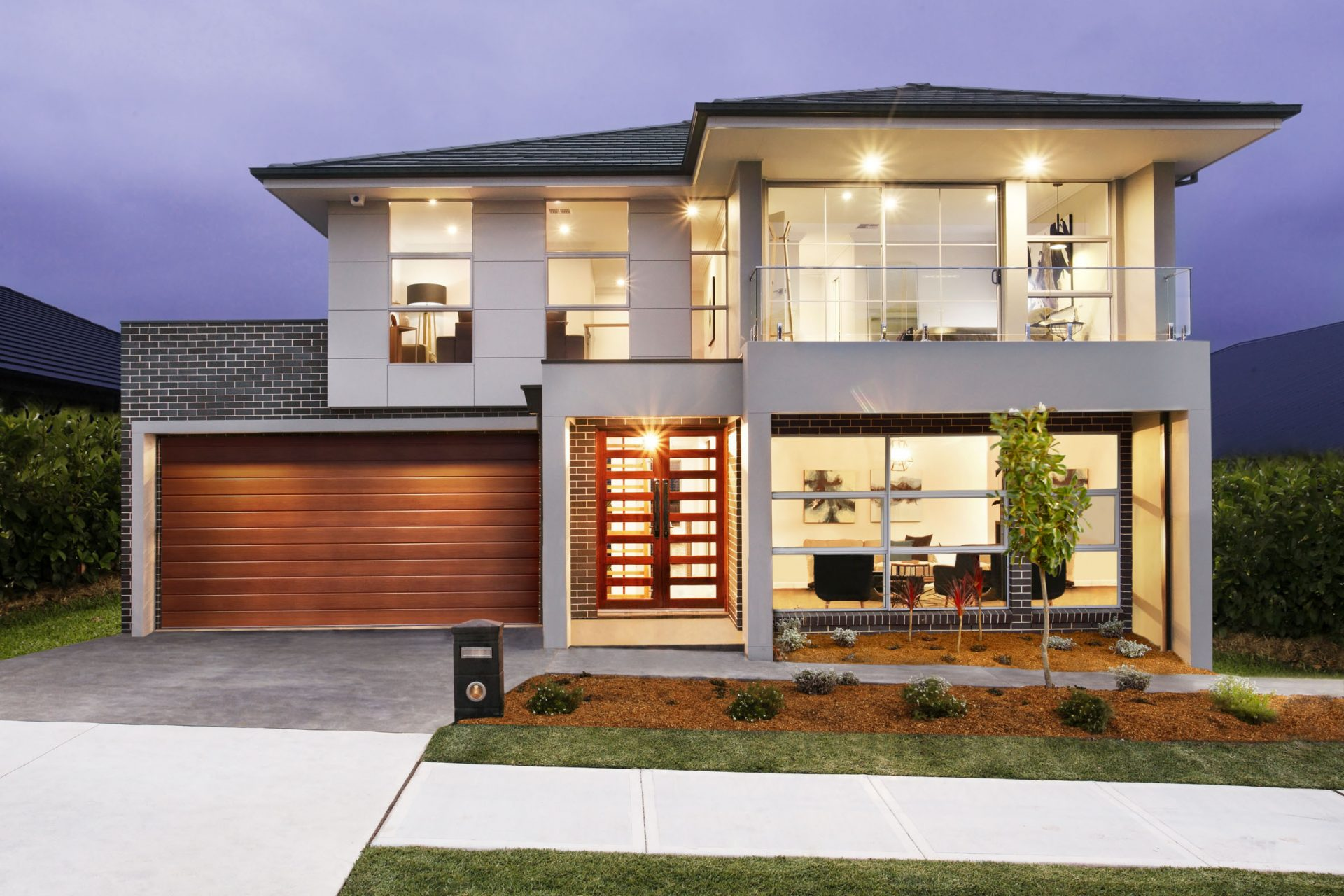 Australis 34 modern fa ade with balcony jandson homes for Contemporary house builders